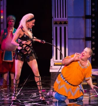 (l-r) Nick Flatto as Protean (background), Jennifer Frankel as Gymnasia and  Bruce Dow as Pseudolus in the Shakespeare Theatre Company's production of A Funny Thing Happened on the Way to the Forum, (Photo: T. Charles Erickson)