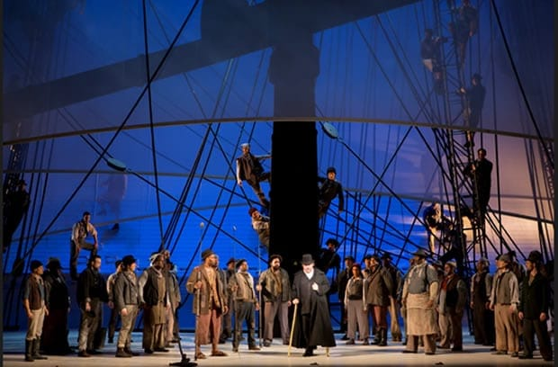Carl Tanner as Captain Ahab (center) and the company of Moby-Dick. (Photo: Scott Suchman for WNO)