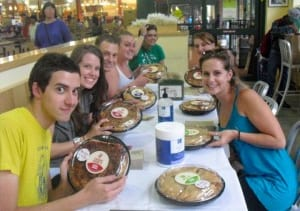Pointless company members Matt Reckeweg, Aaron Bliden, Sarah Wilby, Patti Kalil, Rachel Parks and Lee Gerstenhaber gather with friend Brooke Shoemaker to compete in a pie eating contest .