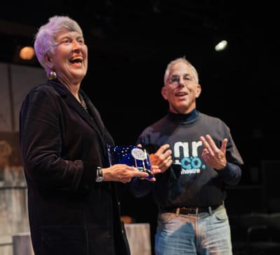 Barbara Bear receiving the Gary Lee Maker Audience Award from 2012 co-recipient Tom Holzman (Photo: Matailong Du)