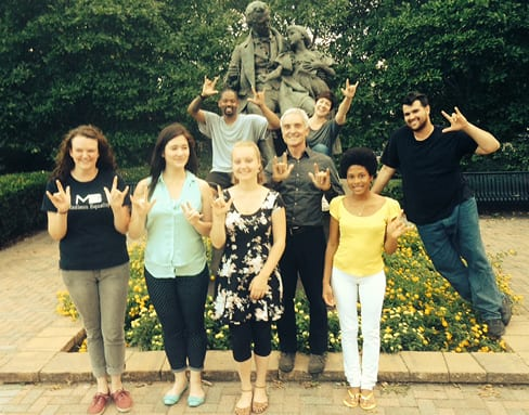 "Eight actors from the 16-member Visible Language cast at the statue of Thomas H. Gallaudet (""the father of American Sign Language"" and the father of Edward Miner Gallaudet) on the campus of Gallaudet University."
