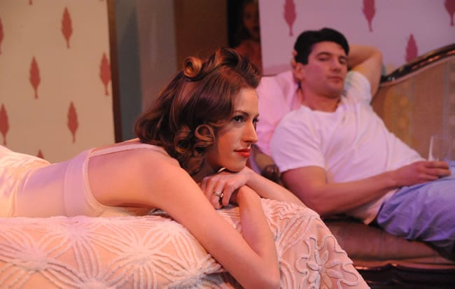 Katrina Clark as Maggie and Jacques Mitchell as Brick in Cat on a Hot Tin Roof at Compass Rose Theater (Photo: Stan Barouh)