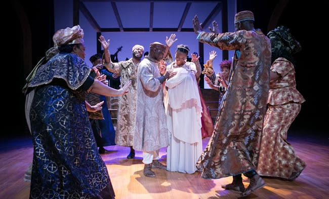 The ensemble of Black Nativity (center) G. Carlos Henderson and Ny'a Johnson. (Photo: C. Stanley Photography)