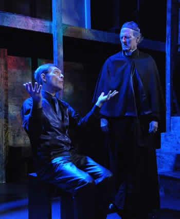Ray Schultz as the Fourth Tempter and Charles Matheny as Thomas Becket (Photo: Stan Barouh)