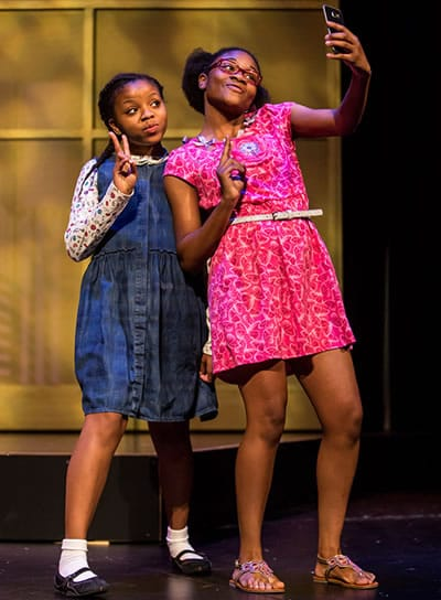 Johannah Easley as Akeelah and Zaria Graham as Georgia in Children's Theatre Company's Akeelah and the Bee at Arena Stage at the Mead Center for American Theater (Photo: Dan Norman)
