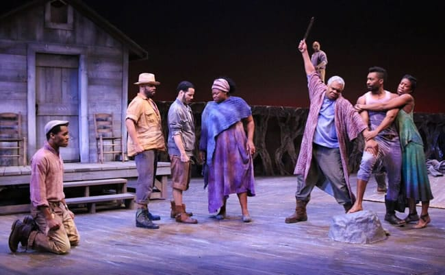 (l-r) Ian Anthony Coleman (as Fourth), Jefferson A. Russell (as Leader), Jon Hudson Odom (as Second), Stori Ayers (as Third), Craig Wallace (as Oldest Old Man), KenYatta Rogers (as Homer), JaBen Early (as Hero), and Valeka J. Holt (as Penny) in Round House Theatre's production of Father Comes Home From The Wars (Parts 1, 2 & 3) by Suzan-Lori Parks. (Photo: Cheyenne Michaels)