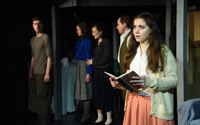 (l-r) Eli Pendry as Peter, Jenny Donovan as Margot, Alicia Sweeney as Mrs. Frank, Steve Lebens as Mr. Frank, and Mia Goodman as Anne in The Diary of Anne Frank at Compass Rose Theater (Photo: Stan Barouh)