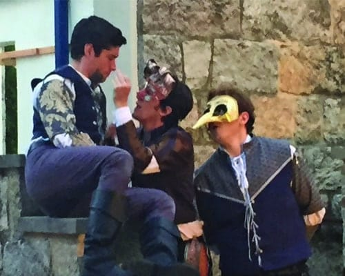 "(l-r) Séamus Miller as Romeo, Vince Eisenson as Mercutio (curly mask), and Matthew Ancarrow as Benvolio (bird mask) in Chesapeake Shakespeare Company's outdoor ""movable"" production of Shakespeare's Romeo and Juliet (Photo: Lesley Malin)"
