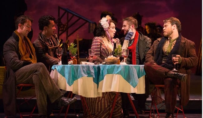 "(l-r) Rhys Lloyd Talbot as Colline, Brian Vu as Schaunard, Raquel González as Mimì, Michael Brandenburg as Rodolfo and Hunter Enoch as Marcello in The Glimmerglass Festival production of Puccini's La Bohème."" (Photo: Karli Cadel/The Glimmerglass Festival)"