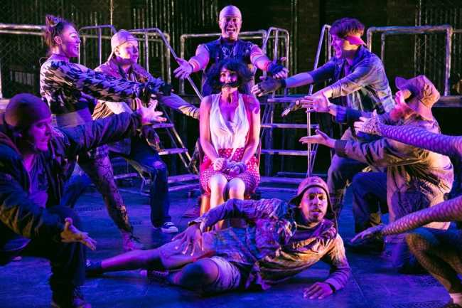 9l-r) Rick Westerkamp, Emily Madden, Harrison Smith, Patrick Murphy Doneghy, Katie Keyser (center), Christian Montgomery, Matthew Aldwin McGee, Carl Williams (floor) in Constellation Theatre's Urinetow: The Musical (Photo: Daniel Schwartz)