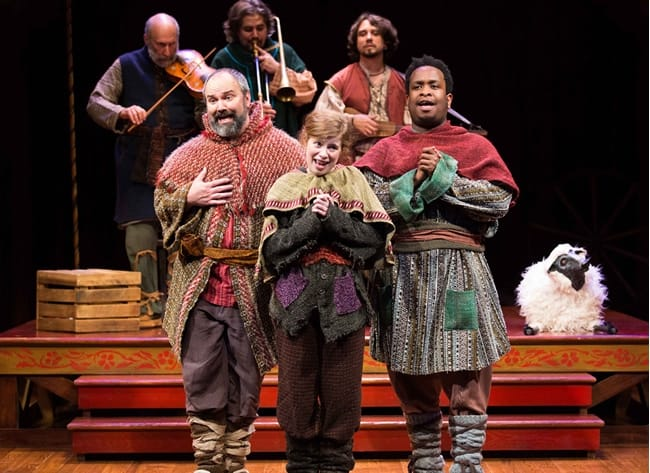 Matthew R. Wilson (left), Megan Graves, and Louis E. Davis sing along to a medieval English tune played by musicians Robert Eisenstein, Daniel Meyers, and Brian Kay in The Second Shepherds' Play. at Folger Theatre (Photo: Brittany Diliberto)