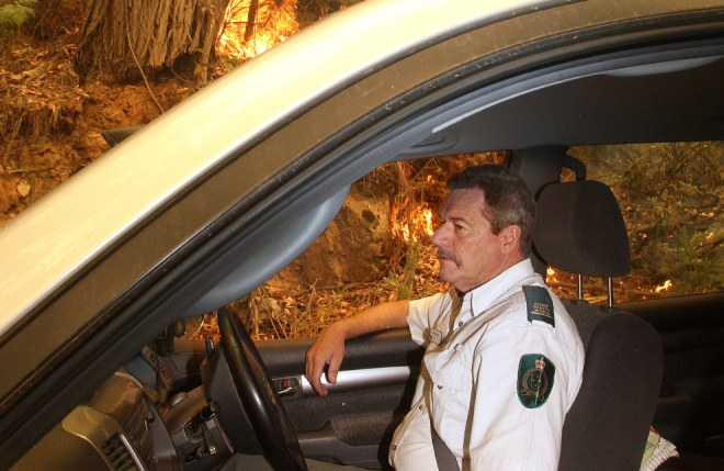 Senior Wildlife Officer Geoff McClure inspects the fire front at Mt. Cathederal, near Alexandra, some 120 kilometres northeast of Melbourne on February 9, 2009. (WILLIAM WEST/AFP/Getty Images)