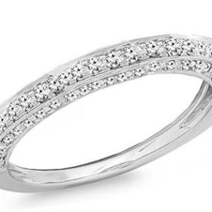 white gold band with diamonds on top and both sides