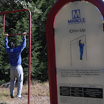 Photo of a man doing chin-ups on the nature trail