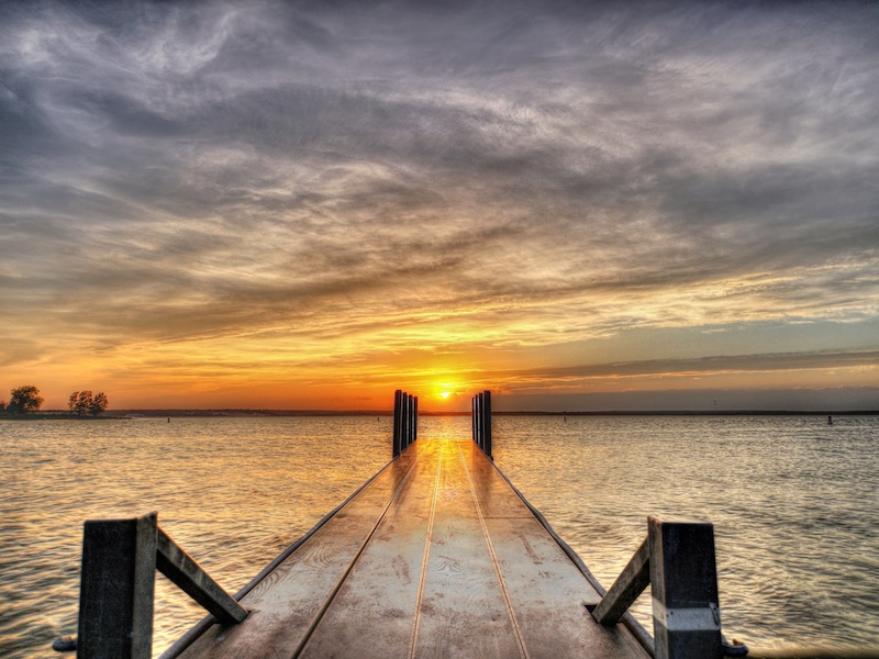 Photo of a dock at Lake Whitney at sunset