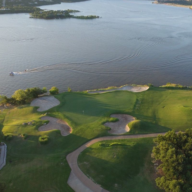 photo of a golf course and lake