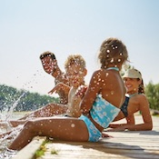 Photo of a family splashing on the dock