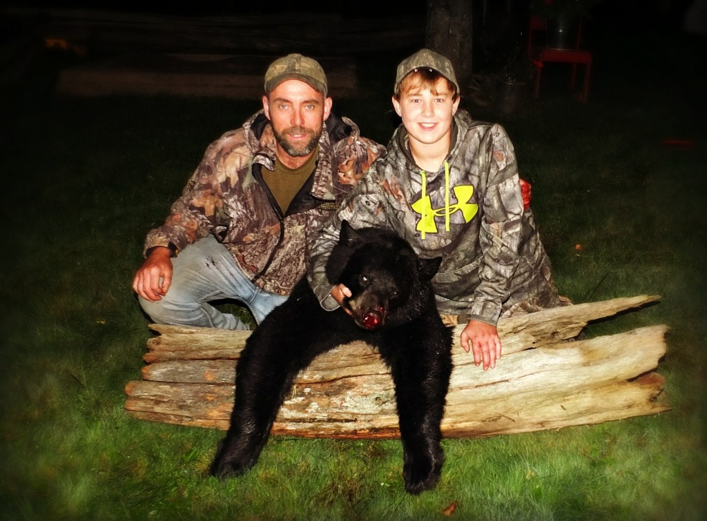 A successful bear hunt in New Brunswick, Canada.
