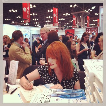 Richelle Mead signing stacks of her new adult series.