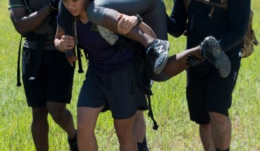 recruits carry each other