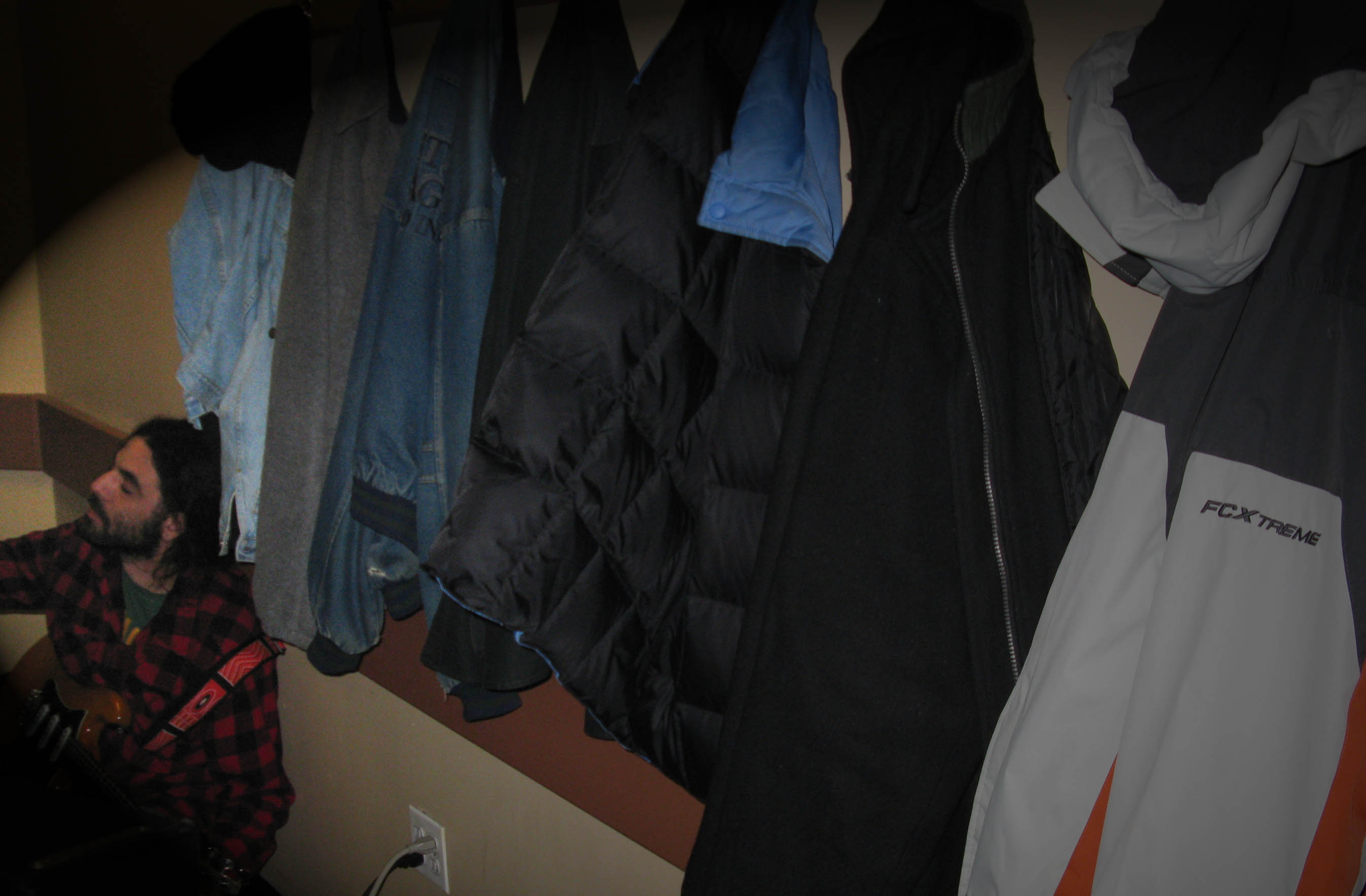 It is no longer summer as the coats on the wall inidcate