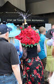 (Photograph by: Greg Bixby) Cheers to Derby hats! Cheers to Derby hats!