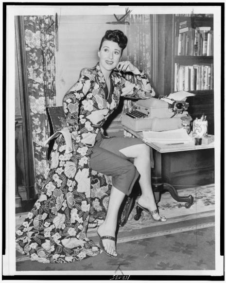 Palumbo, Fred, photographer. [Gypsy Rose Lee, full-length portrait, seated at a typewriter, facing slightly right/ World Telegram & Sun photo by Fred Palumbo]. 1956. Image. Retrieved from the Library of Congress, https://www.loc.gov/item/94511004/. (Accessed January 06, 2017.)