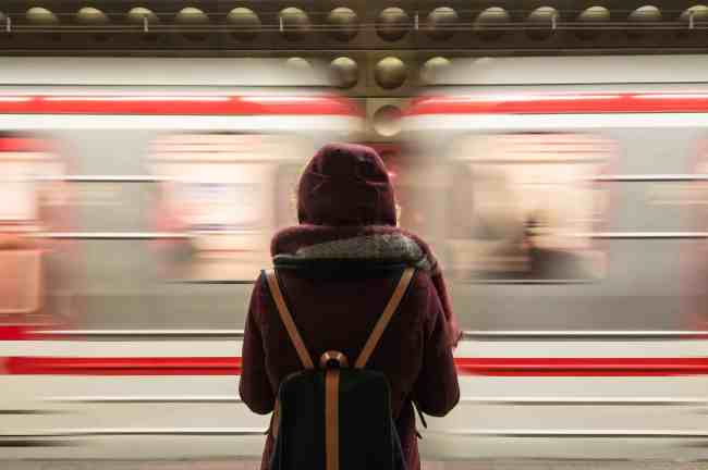 Person on platform as train speeds by