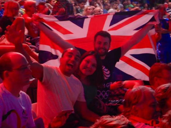 My friends and I waving in front of a Union Jack