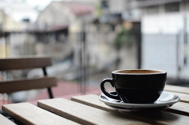 Coffee cup sitting on outdoor table