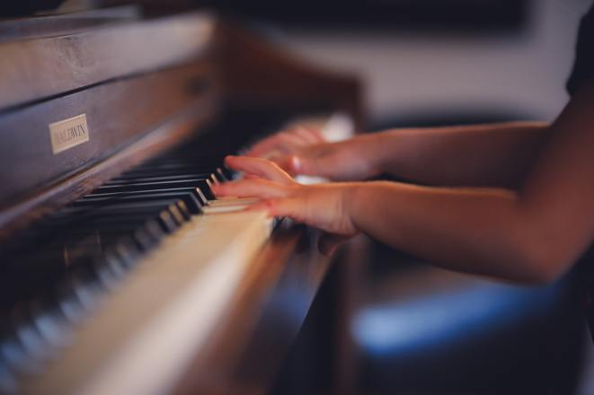 a child plays piano