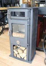 The Chilli Penquin High & Mighty in Charcoal. Standing tall this stove offers an elevated height, oven box, generous top plate, convection panel sides and integral log plinth.