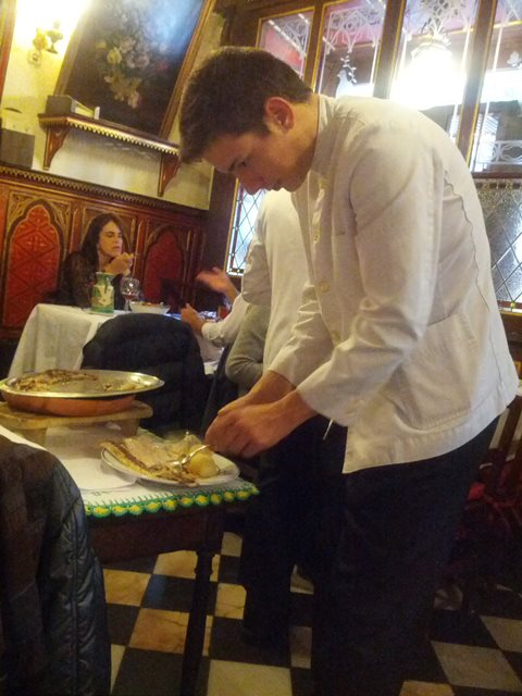 waiter deboning fish tableside - photo by Dean Curtis, 2014