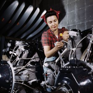 Woman_working_on_an_airplane_motor_at_North_American_Aviation,_Inc.,_plant_in_Calif (1)