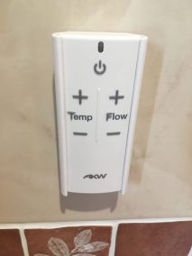Remote control lift-out shower controls