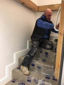 Dean applying carpet protector to the stair carpet before work starts
