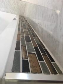 Kendal bathroom - shampoo shelf (ok, wine shelf!) with mosaic tiles