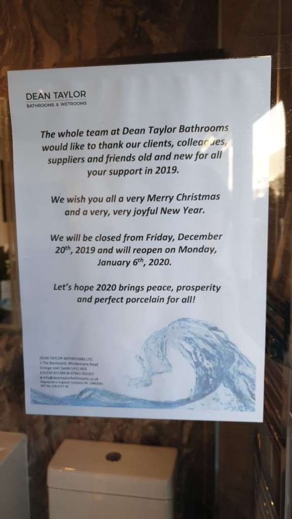 Notice in the window of Dean Taylor Bathrooms showroom advising of our closing dates for Christmas 2019