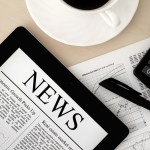 bigstock-Apple-Ipad-With-News-On-Desk-24449495