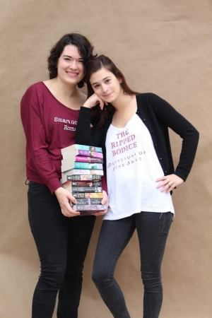 Leah and Bea with book pile