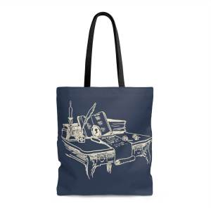 Navy tote bag with a Regency style escritoire on it