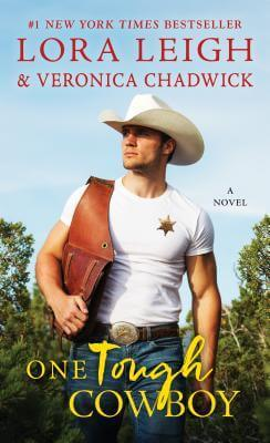 Hot cowboy walking through a leafy field wearing jeans and a white t-shirt and white stetson, carrying saddlebags over one shoulder and with a sheriff's badge on his tee.