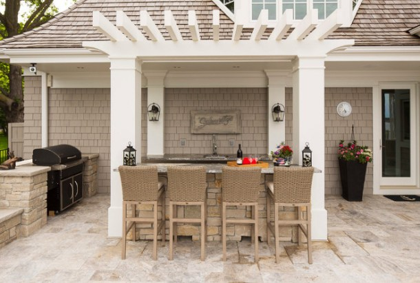 bar-is-complete-with-a-barbecue-sink-and-refrigerator.-The-beautiful-natural-stone-patio-brings-it-all-together.-outdoorkitchen-pergola-outdoors-Southview-Design