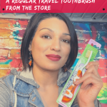Person holding travel toothbrush