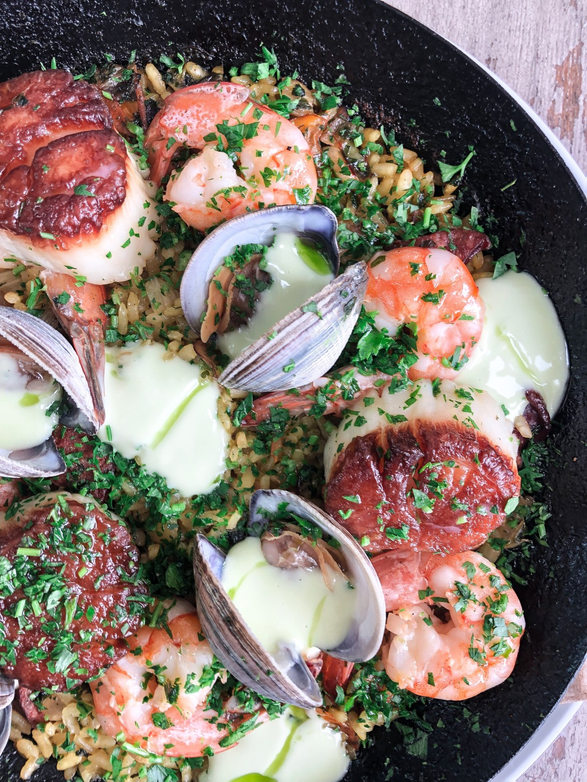 This Seafood Paella Recipe teaches you how to perfectly cook the fish and the rice!