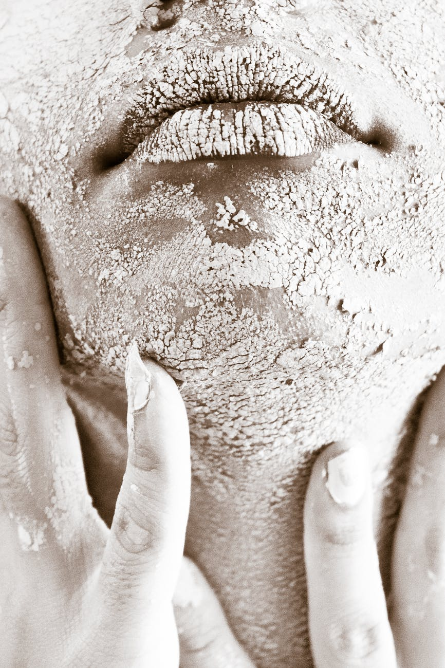 person s face covered with white powder