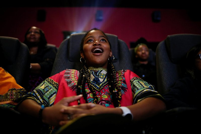 "Ron Clark Academy 6th grader De Ja Little, 12, joins classmates in watching the film ""Black Panther"" at Atlantic Station theaters in Atlanta"