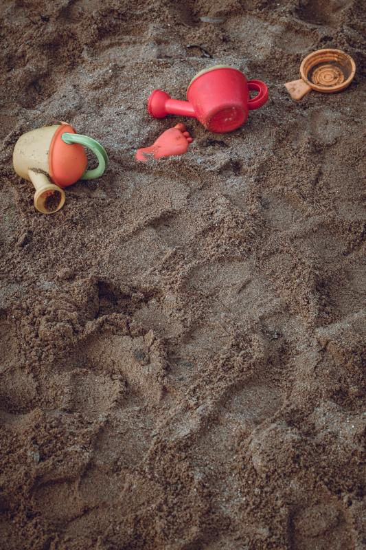 children toys in the sand