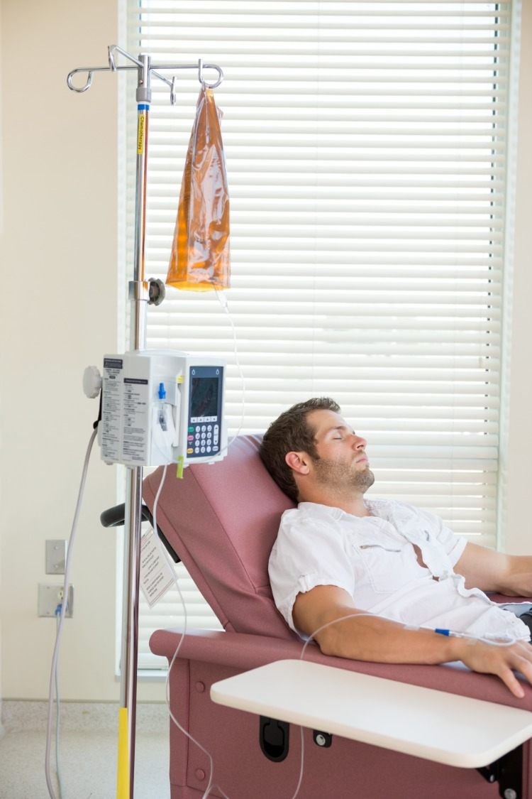 sleeping patient undergoing cancer treatment in hospital