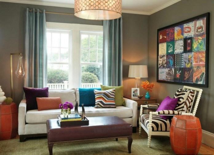 decoration-salon-coussins-décoratifs-tableau-collae-ottoman-cuir-marron